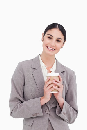 Smiling businesswoman holding paper cup against a white background Stock Photo - 18681705