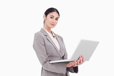 Side view of businesswoman with laptop against a white background photo