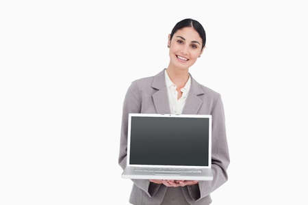 Smiling businesswoman showing screen of her notebook against a white background photo