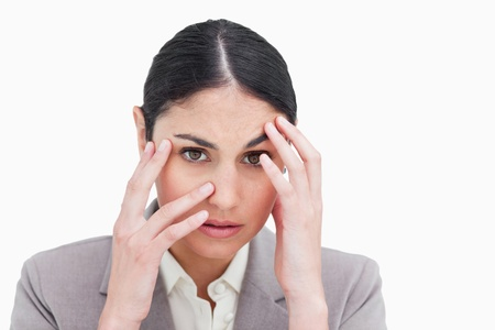 Close up of frustrated looking businesswoman against a white background Stock Photo - 13649913