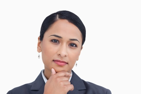 Close up of saleswoman in thinkers pose against a white background photo