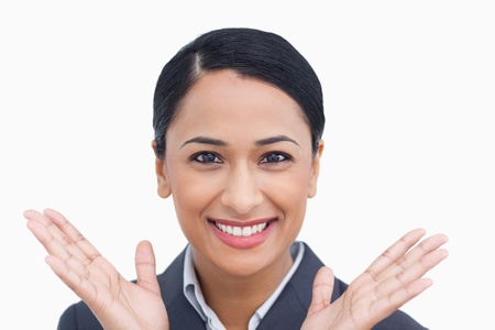 Close up of positive surprised saleswoman against a white background photo