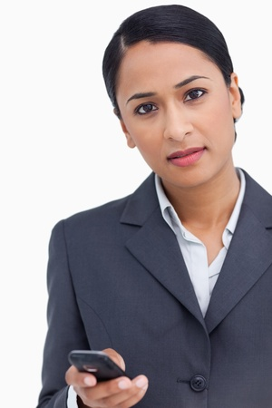 Close up of saleswoman holding cellphone against a white background photo