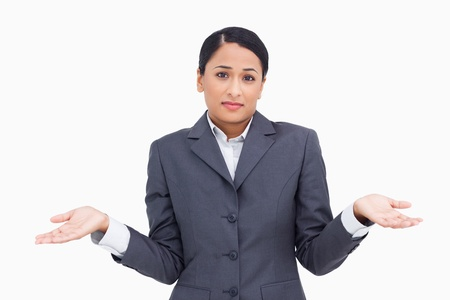 clueless: Close up of clueless saleswoman against a white background