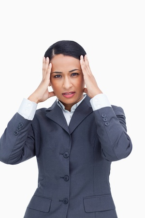 Close up of saleswoman experiencing a headache against a white background photo