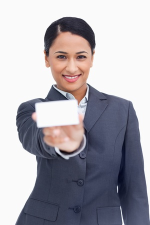 Close up of smiling saleswoman showing her business card against a white background photo