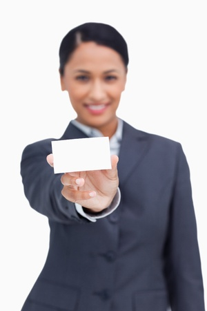 Close up of business card being shown by saleswoman against a white background photo
