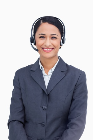 Close up of smiling telephone service employee against a white background photo