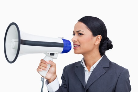 Close up of saleswoman using megaphone against a white background photo