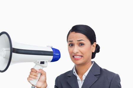 Close up of afraid saleswoman with megaphone against a white background photo