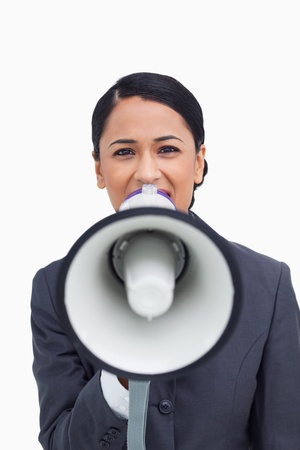 Close up of saleswoman with megaphone against a white background Stock Photo - 13653970