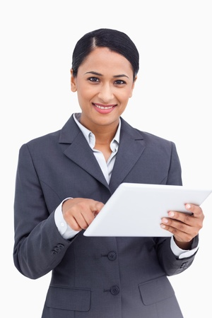 Close up of saleswoman using touch screen computer against a white background photo