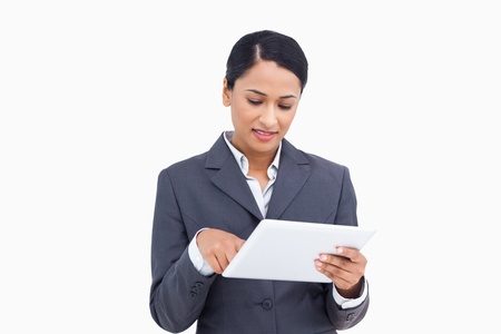 Close up of saleswoman with her touch screen computer against a white background Stock Photo - 13648643