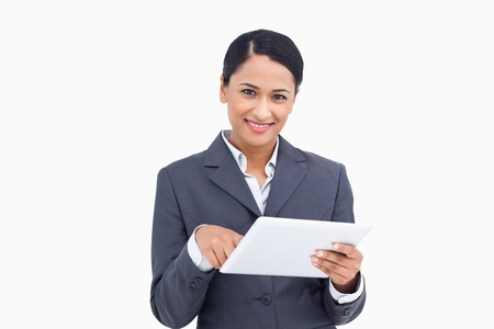 Close up of saleswoman with tablet computer against a white background Stock Photo - 13648861
