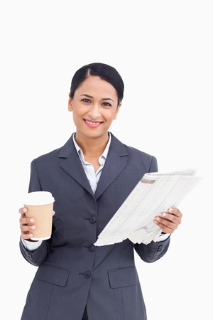 Close up of smiling saleswoman with paper cup and newspaper against a white background Stock Photo - 18681527