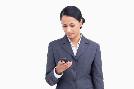 Close up of saleswoman writing text message against a white background photo