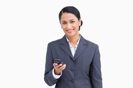 Close up of smiling saleswoman holding cellphone against a white background photo