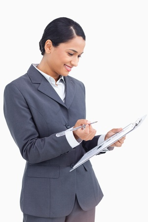 Close up of saleswoman with clipboard and pen against a white background photo