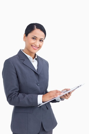 Close up of saleswoman with pen and clipboard against a white background photo