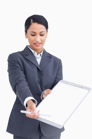 Close up of saleswoman asking for signature against a white background photo