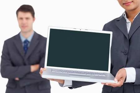Close up of laptop screen being presented by salesteam against a white background photo