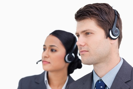 Close up of call center team against a white background photo