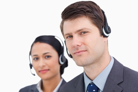 Close up of call center employees against a white background photo