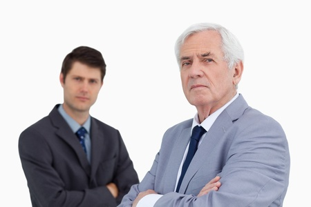 Close up of businessmen with arms folded against a white background photo