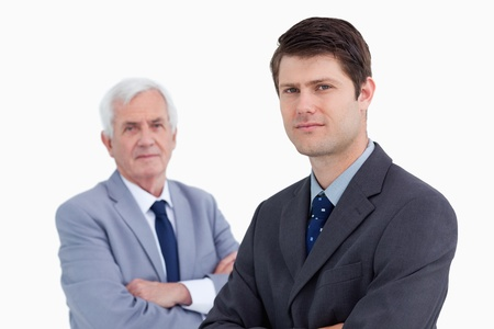 Close up of young businessman with his mentor behind him against a white background photo