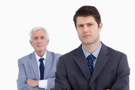 Close up of businessman with his boss behind him against a white background photo