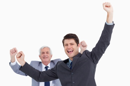 Close up of celebrating businessmen against a white background photo