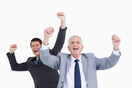 Close up of cheering businessmen against a white background photo