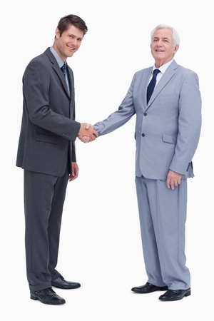 Side view of businessmen shaking hands against a white background photo
