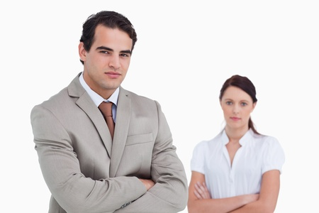 19's: Salesman with arms crossed and colleague behind him against a white background
