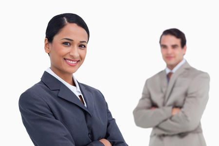 Smiling saleswoman with colleague behind her against a white background photo