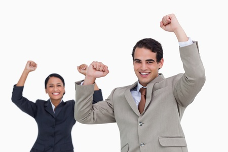 Celebrating salesman with colleague behind him against a white background photo