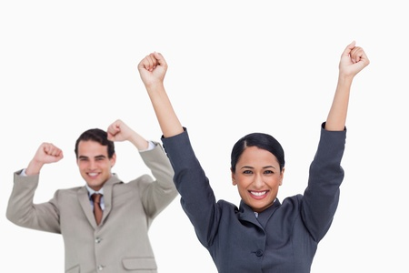 Cheering saleswoman with colleague behind her against a white background Stock Photo - 18681450