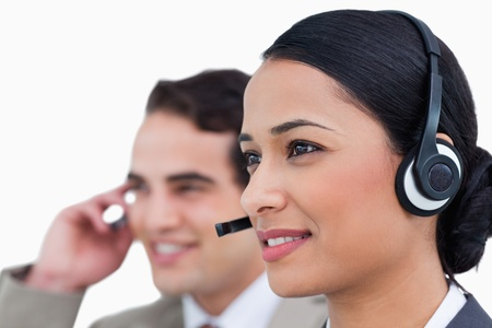 Close up side view of call center agents against a white background photo