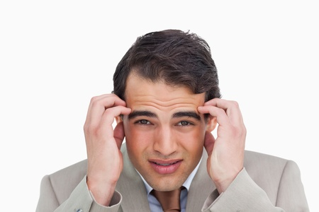 Close up of salesman experiencing a headache against a white background photo