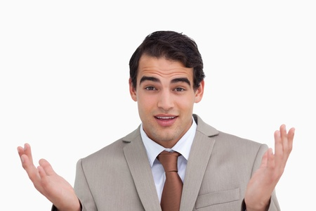 clueless: Close up of clueless salesman against a white background Stock Photo