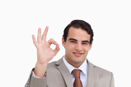 Close up of salesman giving his approval against a white background photo