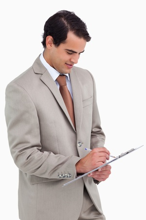 Salesman taking notes against a white background photo