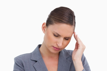 Close up of tradeswoman having a headache against a white background photo
