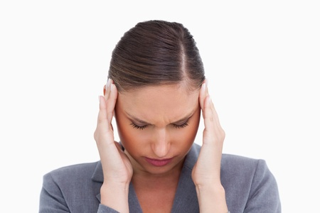 the weariness: Close up of tradeswoman experiencing a headache against a white background