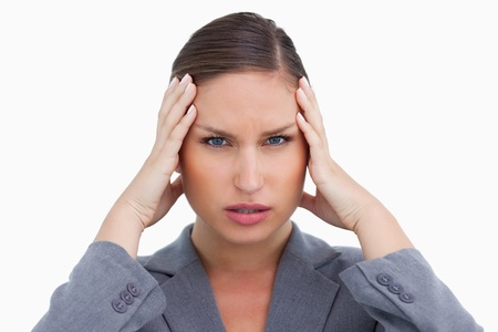 Close up of tradeswoman with headache against a white background photo
