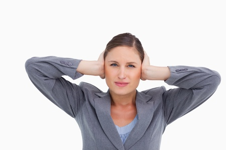 Close up of tradeswoman covering ears against a white background Stock Photo - 13658102