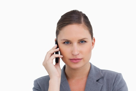 Close up of tradeswoman listening to caller against a white background photo