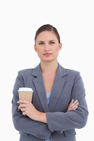 Tradeswoman with arms folded and paper cup against a white background photo