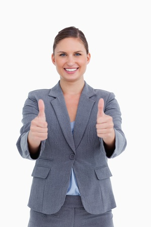 Smiling tradeswoman giving her approval against a white background photo