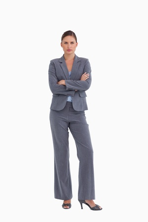 tradeswoman: Tradeswoman standing with her arms folded against a white background